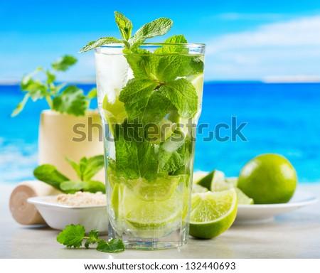 mojito cocktail on beach - stock photo