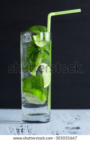 Mojito cocktail on the dark background - stock photo