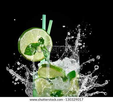 Mojito cocktail over black - stock photo