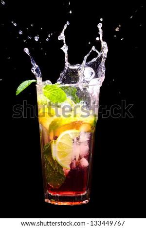 Mojito Cocktail with splash on black - stock photo