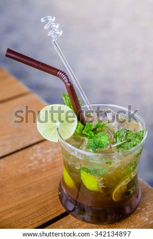 Mojito cocktails shot on a bar counter - stock photo