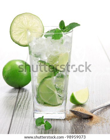 Mojito drink on wooden background - stock photo