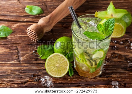 Mojito drink served on wooden planks - stock photo