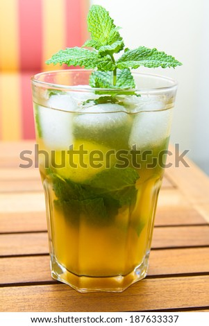 Mojito drink with limes and mint - stock photo