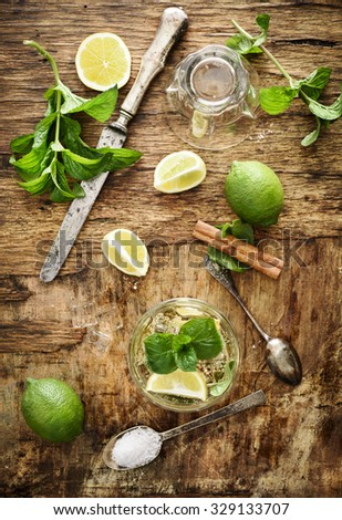 Mojito ingredients on rustic wooden background - stock photo