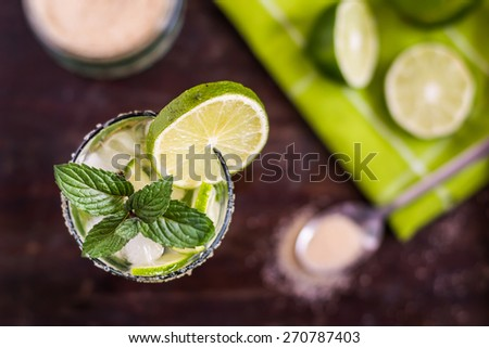 Mojito Lime Alcoholic Drink Cocktail on Wooden Table Overhead - stock photo