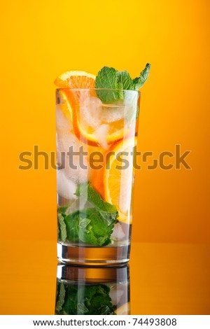 Mojito orange cocktail. on yellow background. - stock photo