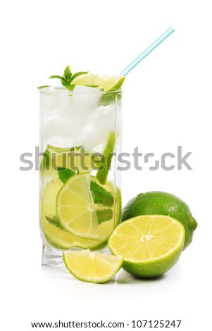 Mojito with lime, mint, ice and fruit near the glass. Isolated on white background - stock photo