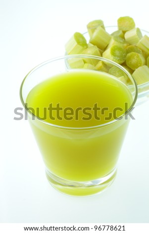 Molasses and sugar cane is cut into the cup. - stock photo