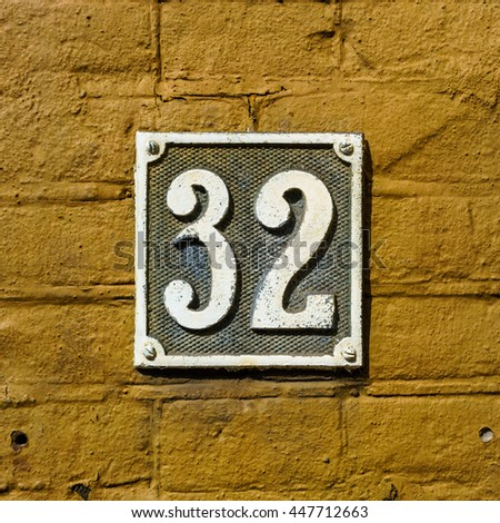 Molded metal house number thirty two - stock photo