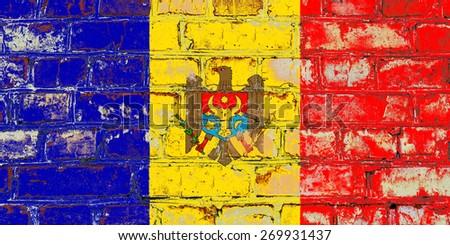 Moldova flag painted on old brick wall texture background - stock photo