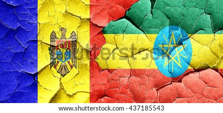 Moldova flag with Ethiopia flag on a grunge cracked wall - stock photo