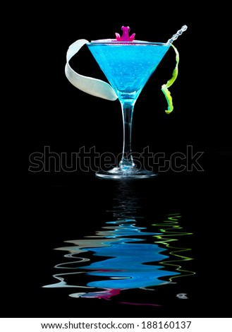 Molecular mixology - Blue swimming pool Cocktail with caviar and flower petals - stock photo