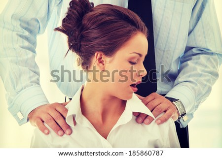Molestation at work concept. Man molestating woman - stock photo