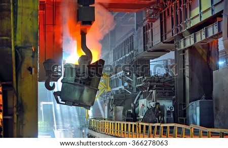 molten metal in ladle for casting - stock photo