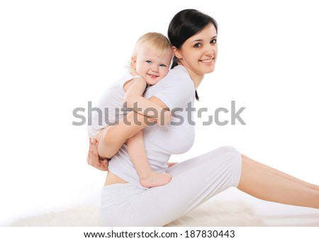 Mom and baby doing exercise home, gymnastics, yoga, fitness and health - concept - stock photo