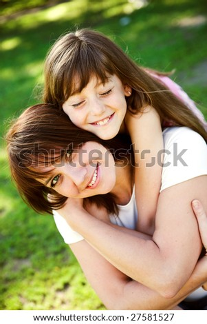 Mom and Daughter Having Fun - stock photo