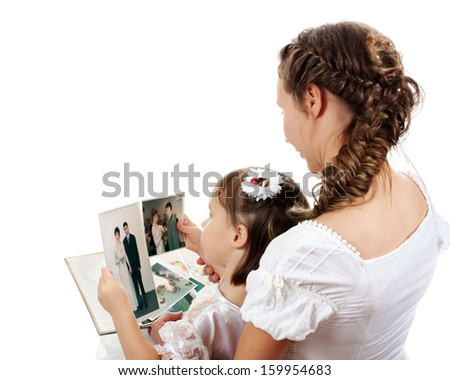 Mom and daughter watch family photo album. - stock photo