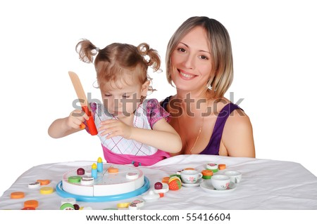 Mom and her little daughter together engaged in crafts - stock photo