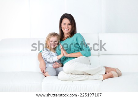 mom and her little girl smiling happy - stock photo