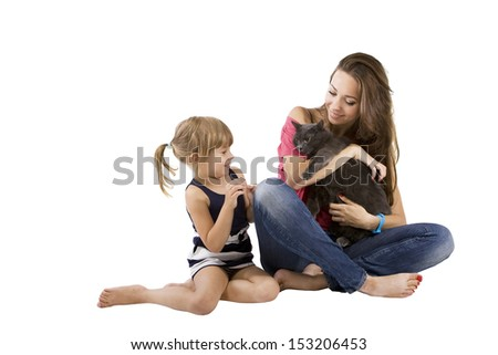 mom and little girl with a cat (child and pet) - stock photo