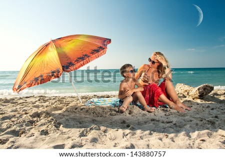 Mom  by the sea - stock photo