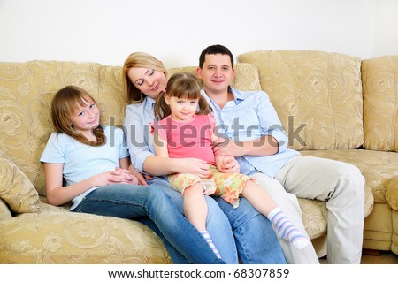 Mom, Dad and their two daughters to spend time together, socialize and enjoy life - stock photo
