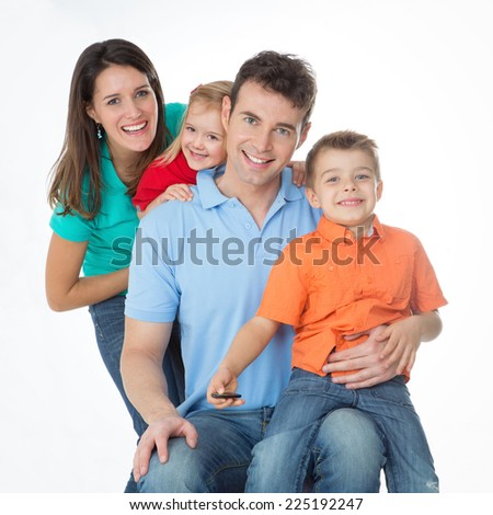 mom, dad and two children in row on white background - stock photo