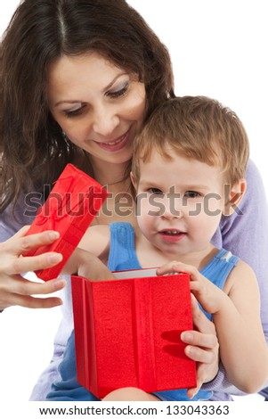 Mom giving gift for her son - stock photo