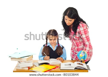 Mom helping daughter with homework isolated on white background - stock photo