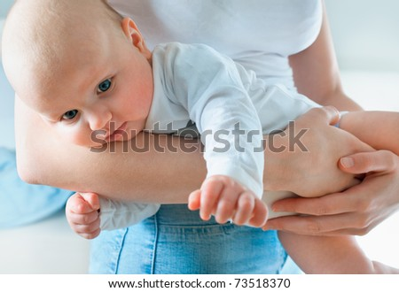 mom holding her baby boy in hands - stock photo
