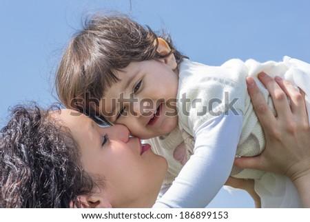 mom holding his baby - stock photo