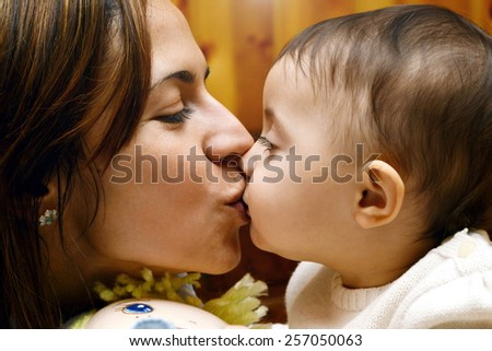 mom kissing and hug baby - stock photo