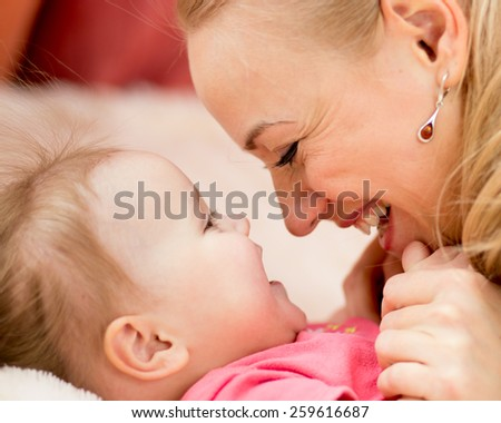 Mom looks with love at child. Parenthood happiness conception. - stock photo