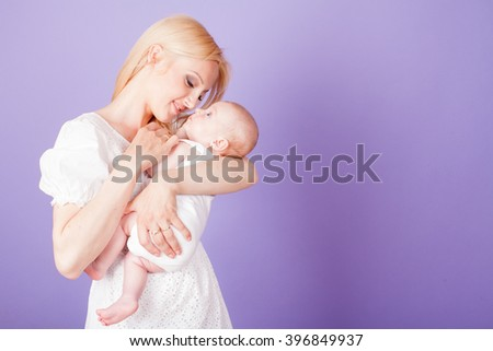 mom mother and baby on the hands - stock photo