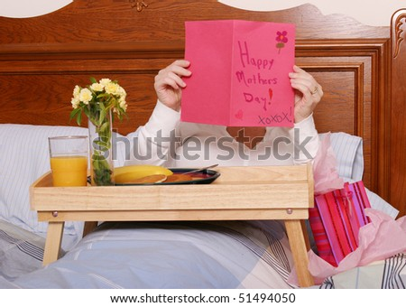 Mom reading card on Mothers Day - stock photo