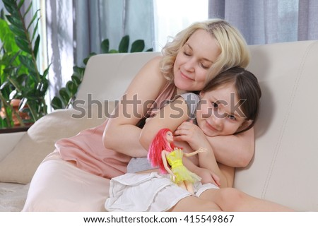 Mom with a child fool around, hugging, laughing. Mom tickling daughter  - stock photo