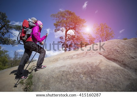 Mom with a child walking in the mountains. - stock photo