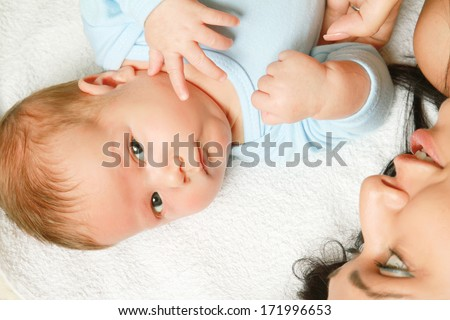 mom with her mixed infant - view from above - stock photo