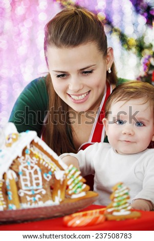 Mom with her son prepare ginger house - stock photo