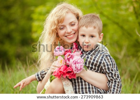 Mom with son and flowers for the Mothers day - stock photo