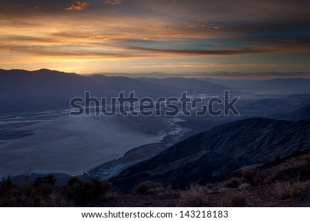 Moments after sunset looking down at Badwater Basin salt flats in Death Valley, CA.  Taken from Dante's View. - stock photo
