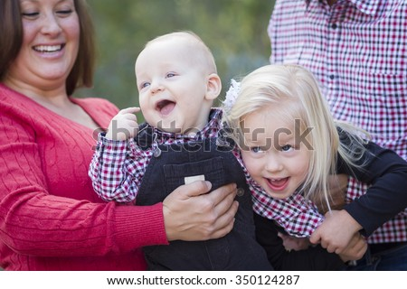 Mommy and Daddy Having Fun with Cute Baby Brother And Sister. - stock photo