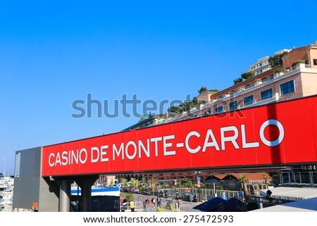 MONACO - APRIL 13, 2015: Casino de Monte-Carlo ad in Monaco. The Monaco Grand Prix is a Formula One motor race held on Circuit de Monaco, a narrow course laid out in the streets of Monaco. - stock photo