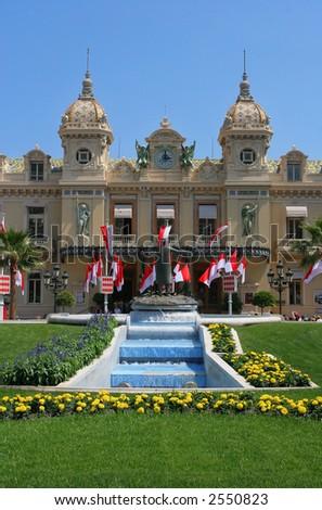 Monaco Casino and national flags - stock photo