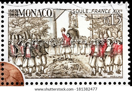 MONACO - CIRCA 1963: A stamp printed by MONACO shows La soule match. La soule, also known as choule, is a traditional team sport that originated in Normandy and Picardy, France, circa 1963  - stock photo