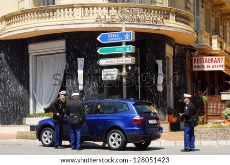 MONACO - MAY 07 2008:Monaco traffic police checks luxury car driver license.Monaco has one of the highest standards of living in the world, material symbols such as  luxury cars are visible everywhere - stock photo