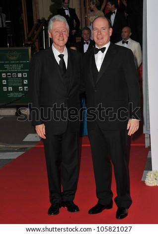 MONACO - MAY 23, 2012: President Bill Clinton & Prince Albert II of Monaco  at the inaugural Nights in Monaco Gala at the Hotel de Paris, Monte Carlo. May 23, 2012  Monaco - stock photo