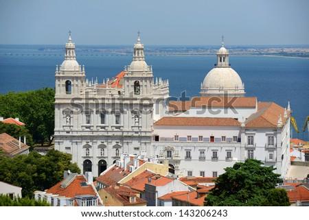 Monastery of Sao Vicente de Fora and Santa Engracia, photo taken from Castelo de Sao Jorge, Lisbon, Portugal - stock photo
