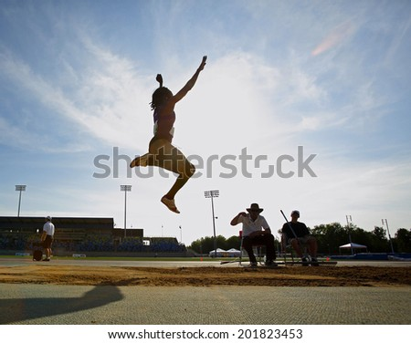 MONCTON, CANADA - June 28: Alicia Smith competes in the women's long jump at the Canadian Track & Field Championships June 28, 2014 in Moncton, Canada. - stock photo